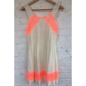 Free people cream dress with neon lace detailing.